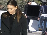 Rooney Mara wears her usual all-black to help a gal pal haul a giant widescreen TV