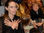 Angelina Jolie's little prince Knox smiles with delight as family join The Lion King cast and crew after Sydney show