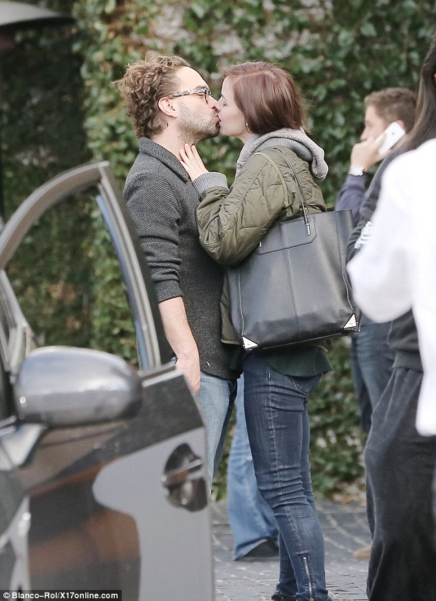 Loose lips: Johnny Galecki and Kelli Garner share a very cosy embrace in an everyday moment