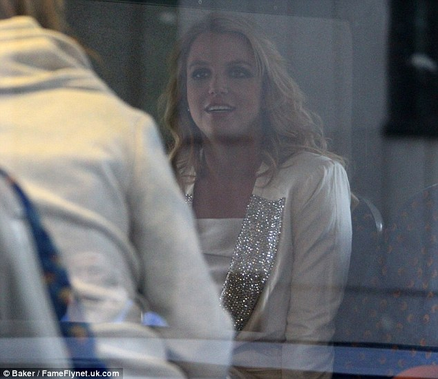 Standing out: Britney teamed her jeans with a sparkly jacket for the bus ride