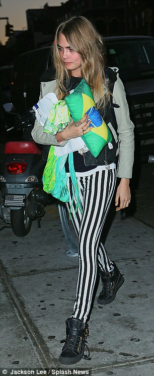 Beetle juice: Cara Delevingne wore striped trousers on Monday night as she carried a screenplay titled,