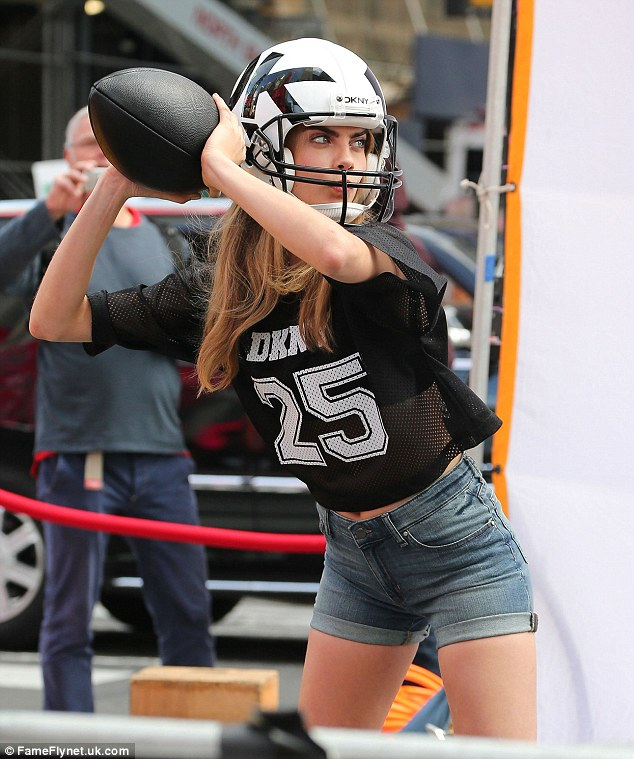 Touchdown: Cara Delevingne and Jordan Dunn were spotted on the set of a DKNY photo shoot in New York City, New York playing a pretend American football
