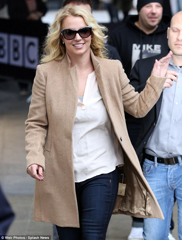 Whoops I did it again: Britney Spears stepped out in London on Wednesday wearing a new coat... but she forgot to remove the label