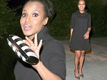 Nothing to see here! Pregnant Kerry Washington camouflages baby bump with a loose-fitting dark frock as she enjoys a friend's holiday party