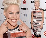 Pink looks thrilled to receive Billboard's Woman of the Year honor while clad in bizarre fringed frock