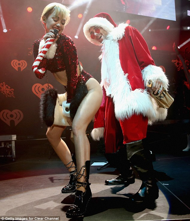 Latest victim: Miley also backed her rear into Santa and twerked on the supposedly family friendly icon