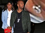 Lovebirds: Kelly Rowland showed up to the Jay-Z concert on Monday night in Los Angeles with her alleged fiancé, manager Tim Witherspoon, looking happy and in love
