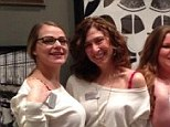 Ladies in red: The staff at the Intimacy boutique on New York's Madison Avenue demonstrate how scarlet bras look invisible under white shirts