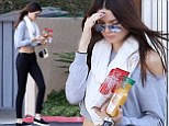 Despite the brisk morning temperatures, Kendall Jenner shows off her sexy midriff at Noah's New York bagels, on the