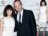 2521165 Getting to grips with his mistress! Ralph Fiennes hugs Felicity Jones at The Invisible Woman premiere