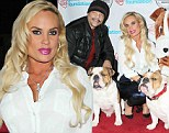 Covered up for once! Coco Austin makes rare fully clothed appearance in skin tight trousers at benefit for Bulldogs