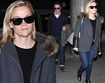 But the sun's gone down Reese! Witherspoon and husband Jim both sport sunglasses after dark as they jet into LAX from Paris