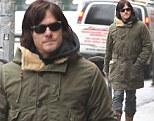 Walking Dead man walking! Norman Reedus looks in high spirits as he goes for a stroll in New York