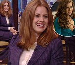 'That's not how I normally present myself': Amy Adams slips into prudish pin-striped pantsuit to promote racy new role in American Hustle