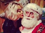 Don't tell Mrs. Claus: Rita Ora posted this fun snap, taken during her promotional visit to Macy's on Sunday