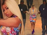 99 Problems...but walking ain't one: Nicki Minaj is flanked by two bouncers as she arrives at Jay Z concert