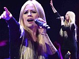 Rocking out: Avril Lavigne performed on Monday at the Jingle Ball concert in Chicago