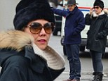 Baby it's cold outside! Maggie Gyllenhaal and husband Peter Sarsgaard rug up against New York's frosty reception