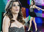 Bellissima! Clooney's ex Elisabetta Canalis thrusts herself back into the spotlight by whipping out her very toned legs in a revealing peplum mini dress