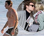 Liev Schrieber shows off his beach body as he takes a dip in the icy Pacific in tiny shorts... after kissing Naomi Watts on set of Pawn Sacrifice