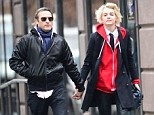 Romantic stroll: Joaquin Phoenix and his DJ girlfriend Allie Teilz were seen parading hand in hand through the East Village on a rainy Tuesday afternoon