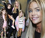Christmas fun: Denise Richards put child abuse allegations behind her as she treated her daughters to a visit with Santa Claus at a fundraising event on Saturday in West Hollywood, California