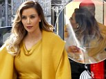 Just call her Kim Cuddle-ashian! Reality star sneaks in tender embrace with fiancé Kanye West during Chanel shopping spree