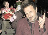 Hardly smelling of roses! David Arquette leaves pregnant girlfriend at home as he parties until early hours (and gets accosted by flower ladies as he exits club)