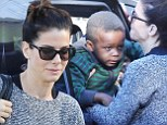 Fighting Gravity! Sandra Bullock works her biceps as she pulls son Louis from her SUV