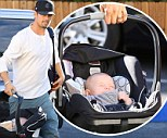 Daddy day care! Josh Duhamel does some not so heavy lifting as he spends the day looking after baby son Axl