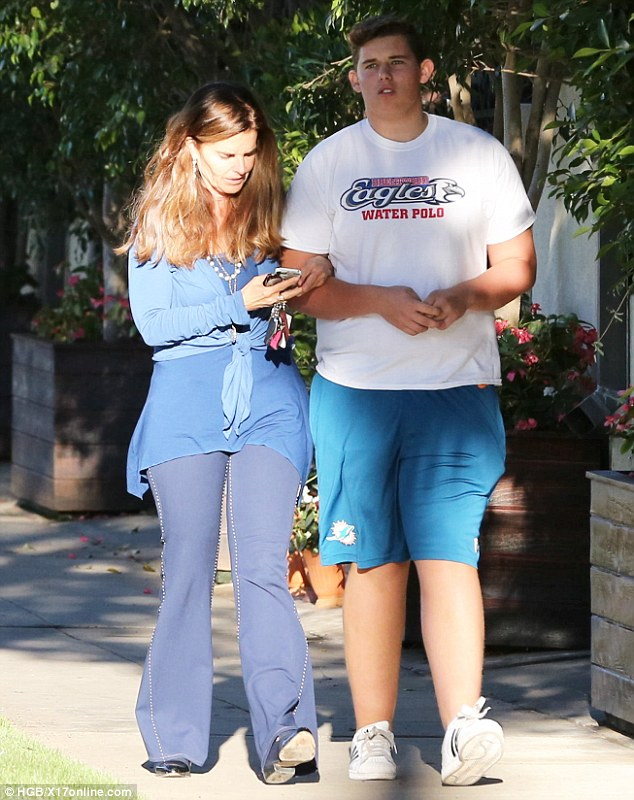 Family support: Maria linked arms with her son Christopher whose father is Arnold Schwarzenegger