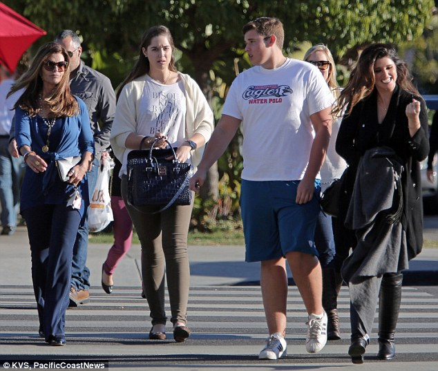 A family day: Maria, Christina, Christopher and Katherine walked side by side to lunch on the sunny day