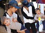 Make-up free Alessandra Ambrosio gives toddler son Noah a lift on Brentwood merry-go-round