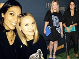 Kristen Bell and Rosario Dawson chat together and tote candy-coloured clutches at The Hobbit video game bash