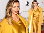 Sunny-side up! Kim Kardashian is overkill in a yellow coat and citrine satin dress as she attends Hollywood Reporter Annual Women in Entertainment Breakfast
