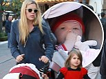 Mommy's little helpers! Busy Philipps' daughters look cute as can be in festive red outfits to meet Santa