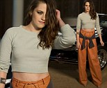 Not your best look... Kristen Stewart wore an awkward pair of orange trousers to attend the Chanel Metiers d'Art Show at Fair Park in Dallas, Texa on Tuesday.