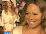 'I downplayed it, but I'm still recovering': Mariah Carey stuns in a satin negligee as she admits to suffering from a July shoulder injury