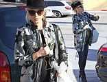 Getting hard to hide! Pregnant Gwen Stefani covertly displays her baby bump as she goes shopping for toys in Studio City, California on Thursday