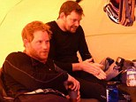 Taking a break: Prince Harry (left) and Team UK as they rest during the Walking With The Wounded trek