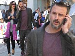 Sorry shopping spree? David Arquette seems to spare no expense for pregnant girlfriend (with noticeable baby bump) after a night of partying