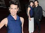 Evangeline Lilly dons unusual sleeveless gown as she cosies up to co-star Orlando Bloom at New York premiere of The Hobbit