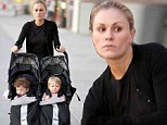 Who needs a nanny? Anna Paquin has double duty as she pushes 15-month-old twins Charlie and Poppy in their pram