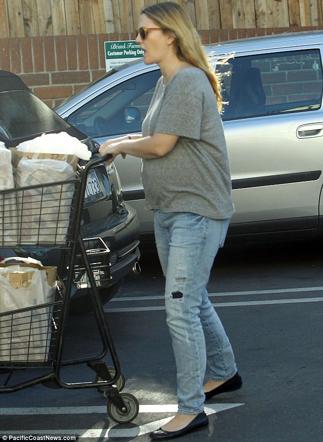 Pushy parent: Drew Barrymore was spotted flaunting her baby belly as she shoved a shopping trolley in Los Angeles on Wednesday