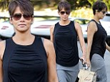 New mom Halle Berry is back to her Bond girl best as she shows off her trim figure in summery ensemble less than 10 weeks after giving birth