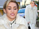 Talk about a complete 180! Miley Cyrus covers up in angelic head-to-toe white in New York following scantily-clad Bad Santa performance
