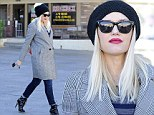 Hollaback Girl: Pregnant Gwen Stefani keeps up her rock-chick image with high-heeled boots and hidden baby bump