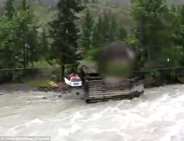 Safe: The car rocks gently on the other side of the river after flying over the raging waters