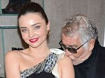 Affection: Roberto Cavalli plants a kiss on Miranda Kerr's shoulder