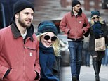 Wrapped up in love! Dakota Fanning braves the cold with much older boyfriend Jamie Strachan on the streets of New York